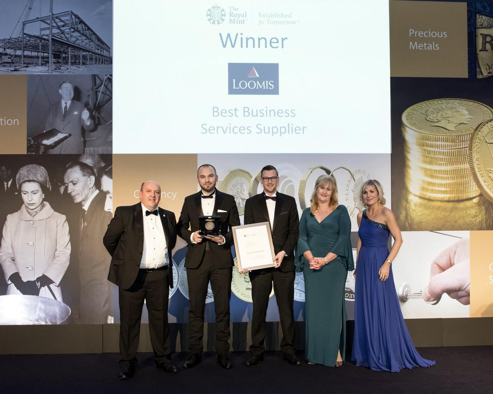 Representatives from Loomis UK accept the award from The Royal Mint