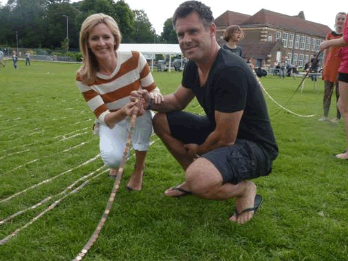 Gabby and Kenny Logan add to the line of pennies with other 'Pennies for Life' volunteers.